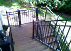 This simple wrought iron railing is custom fit to the difficult turns on this staircase.